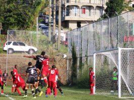 Bert Casimir (black uniform) scores his first of two goals