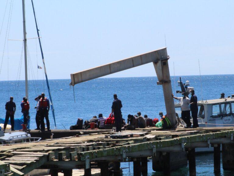 Police detain individuals in Haitian work permit scam