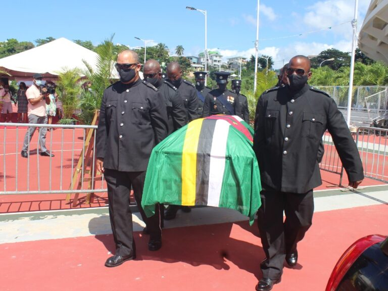 Hundreds file past casket of Grand Bay MP Ed Registe